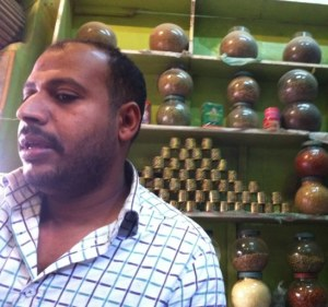 Visualizing the needs & concerns Egyptian small business owners, their families and their employees like this man. Photo by Julie Gomoll.